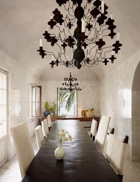 "Courtesy of: www.architecturaldigest.com. Dining gallery: circa-19th-century French chandeliers above a slate table in ""Riviera villa"", interior design by Axel Vervoordt"