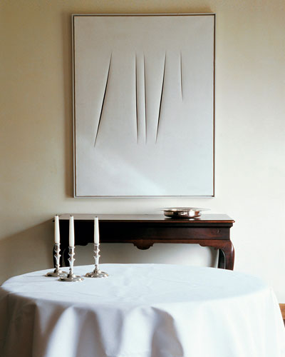 Courtesy of: www.elledecor.com. Detail of interior: on the wall a Lucio Fontana's artwork, design by Axel Vervoordt