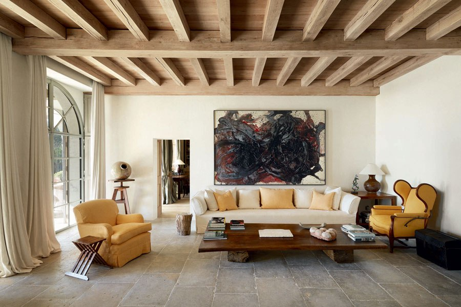 "Courtesy of: www.architecturaldigest.com. Detail of living room: painting by Kazuo Shiraga over a sitting area of ""Portugal's Algarve home"", interior design by Axel Vervoordt"